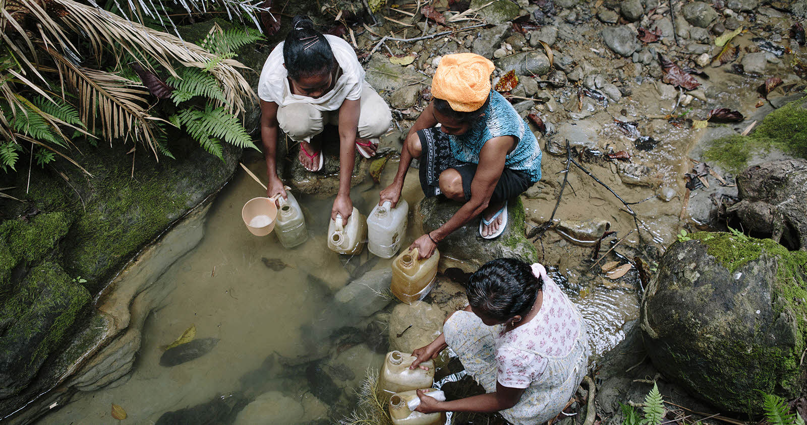 Group of women filling water jugs